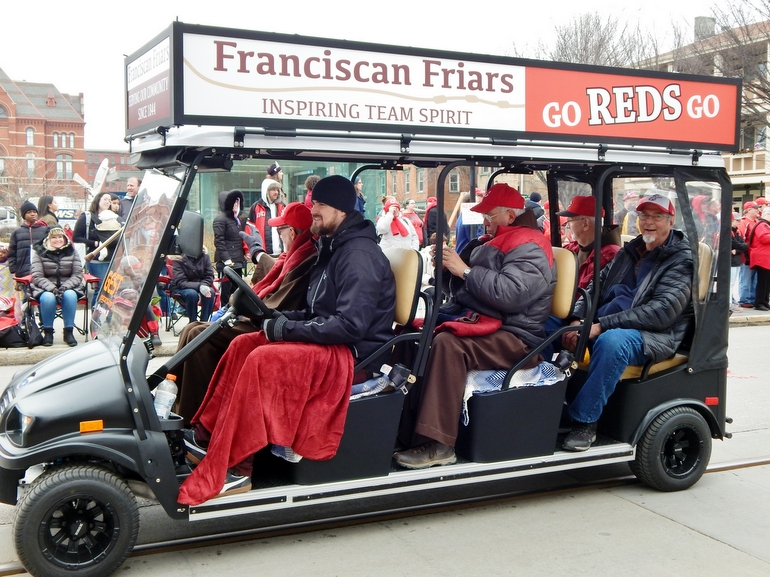 Friars ride in large golf cart