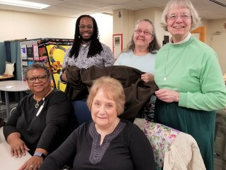 Portrait of five tailors in the Sarah Center workroom