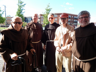 Friars outside movie theater