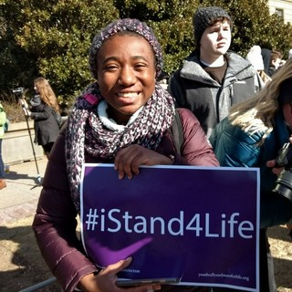 Peaceful protester with #I Stand for Life poster