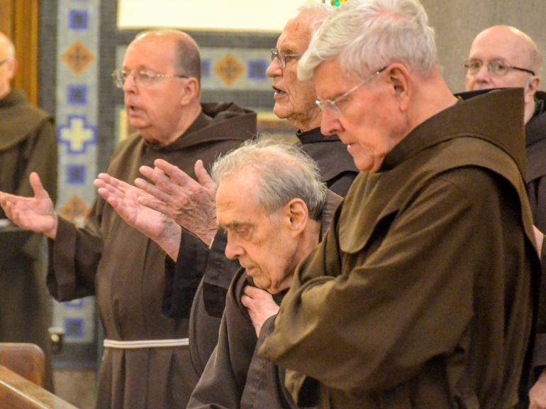 Friars in church