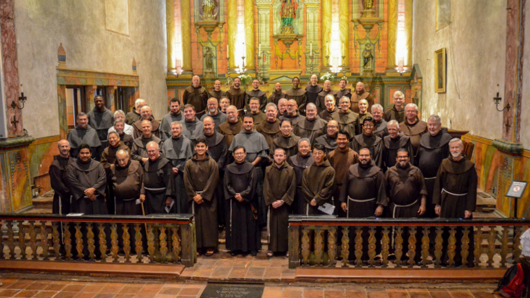 Group of friars in church