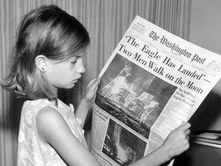 girl hold NY Times