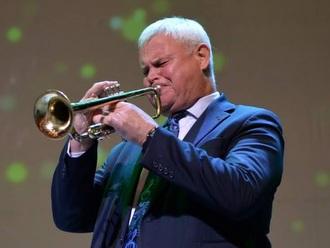 Mayor playing trumpet