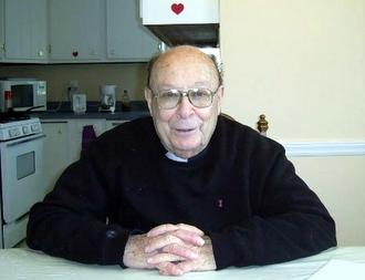 Friar sitting in kitchen