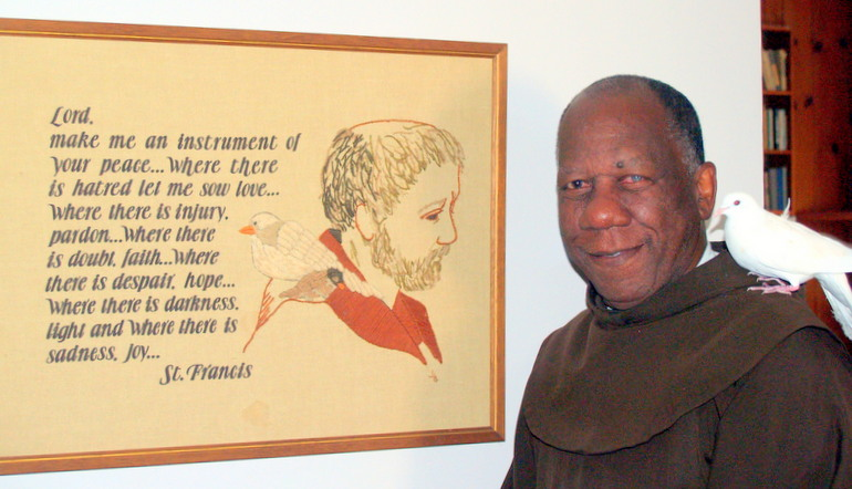Fr. Robert with St. Francis prayer