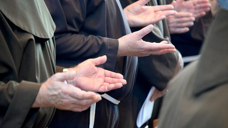 Friars praying