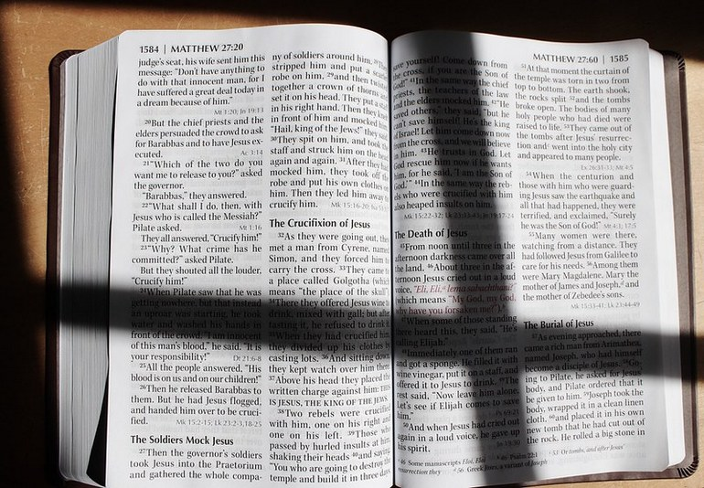 Open Bible with cross shadow