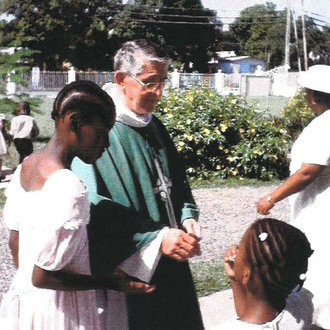 Fr. J.J. with children in Jamaica