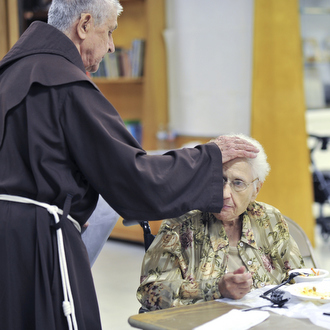 friar praying for woman