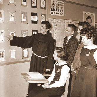 Fr. J.J. in classroom in 1960s