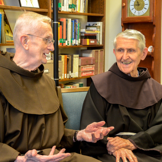 two friars laughing