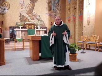 priest holding Mass