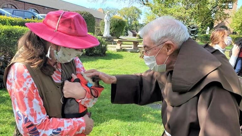 friar blesses pet