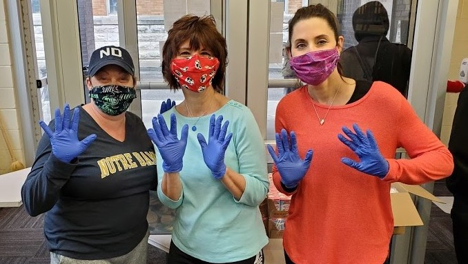 3 women with masks and gloves