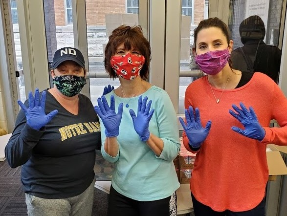 volunteers with masks and gloves
