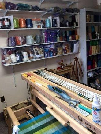 loom and wall of yarns