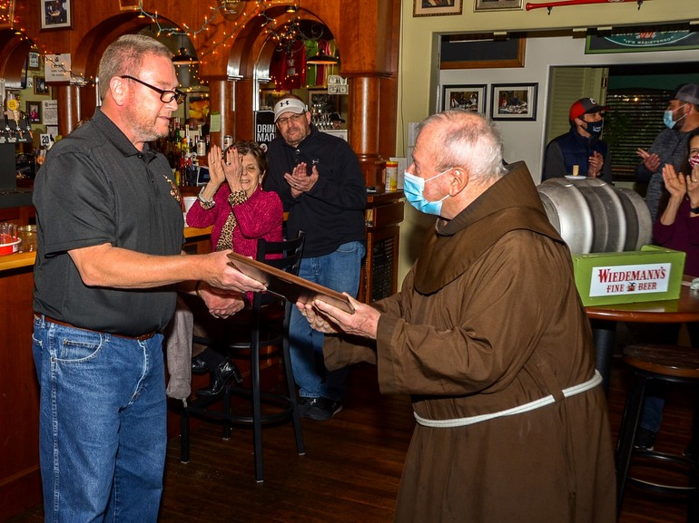 friar accepts award