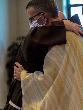 friars hugging