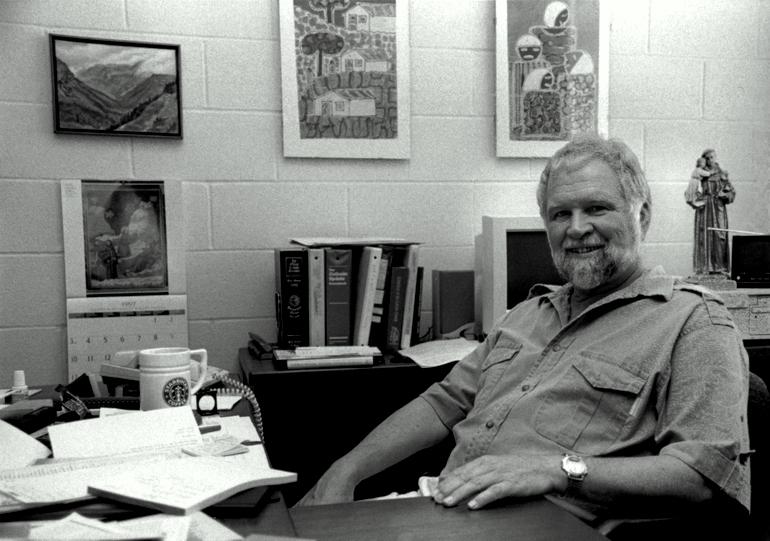 friar at desk