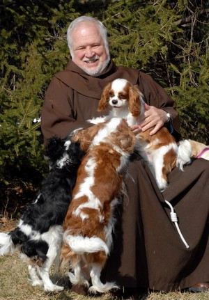 friar with dogs