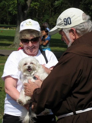 woman holding dog with friar