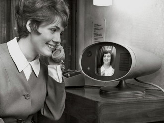 vintage photo of woman using bell picture phone