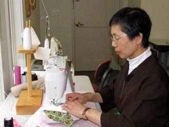 Nun sewing