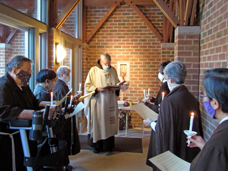 friar and nuns with candles