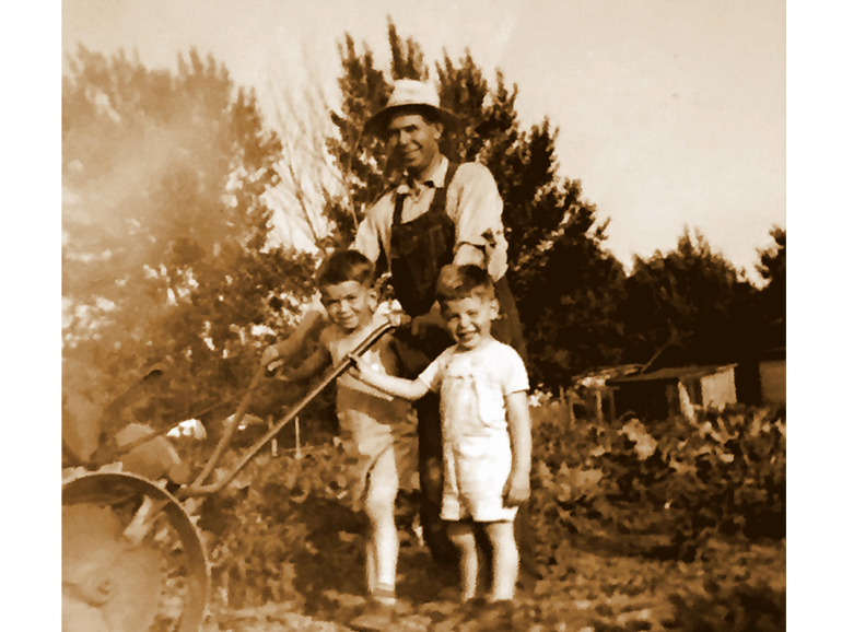 father and sons in garden