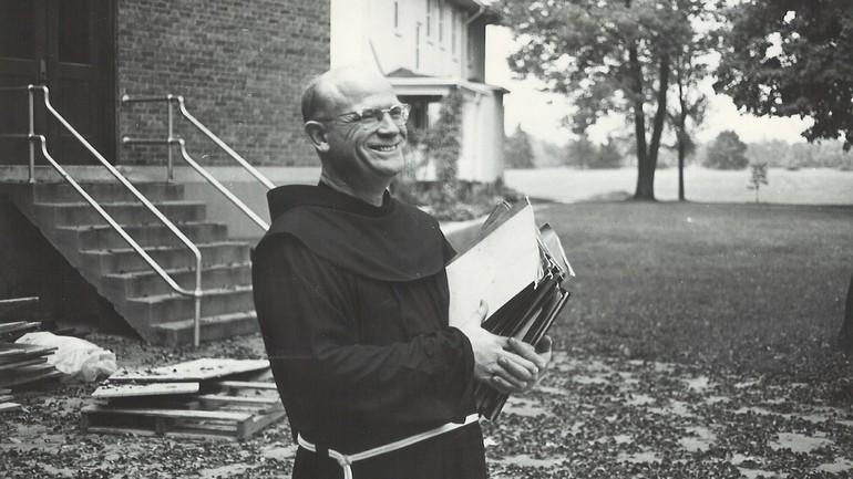 friar holding notebooks