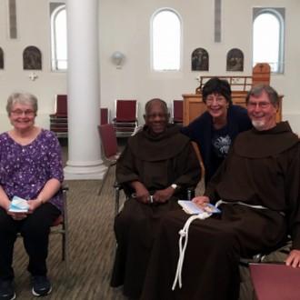 2 friars and parishioners