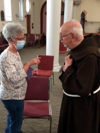 friar and parishioner