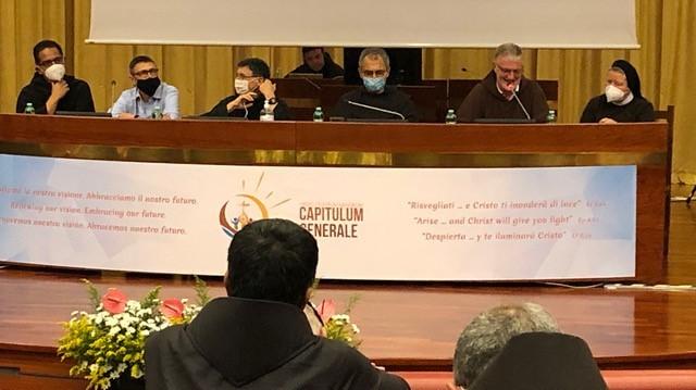 Franciscan leaders at speaker's table