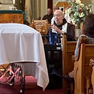 Friar in chapel