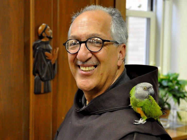 friar with parrot on shoulder