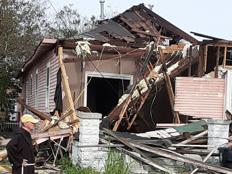 friar with destroyed home