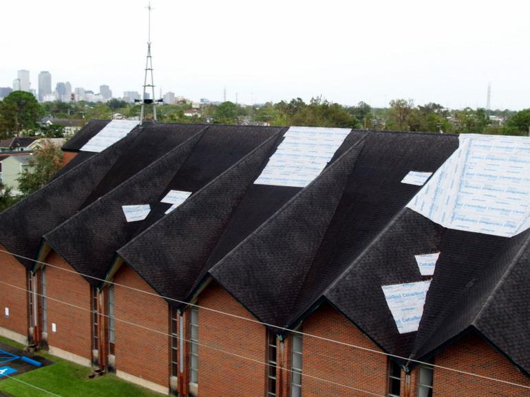tarps on roof of church