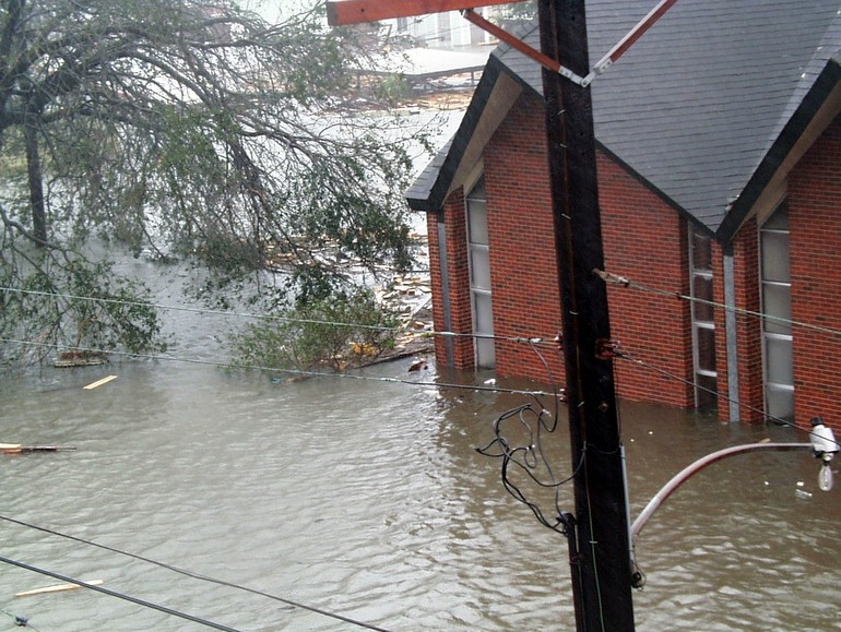 building and flood waters