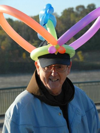 friar with balloons on head